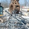 140311 Niagara Produce JOED VIERA/STAFF PHOTOGRAPHER-East Amherst, NY- An excavator bends scrap metal of the old Niagara Produce building during demolition on Tuesday, Mar. 11th, 2014.