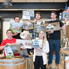 140307 Wine Barrels JOED VIERA/STAFF PHOTOGRAPHER-Lewsiton, NY-Lewport High School students hold up paintings made by other students in their drawing and painting class for a wine barrell project on Friday, Mar. 7th, 2014.
