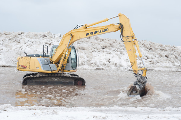 140302 Polar Swim JOED VIERA/STAFF PHOTOGRAPHER-Olcott, NY-An excavator breaks up the ice before the Polar Bear Swim in Olcott Beach on Sunday March 2nd, 2014.