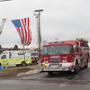 140322 Save the Hospital JOED VIERA/STAFF PHOTOGRAPHER-Newfane, NY-An American flag hangs between fire engines at the Miller Fire Co. on Mar. 22, 2014.