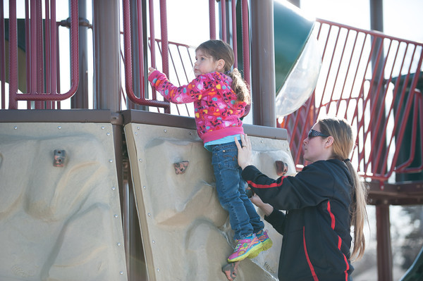 140331 3A Ent JOED VIERA/STAFF PHOTOGRAPHER-Lockport, NY- Jamie Bowes helps her daughter Maycle climb the jungle gym at Day Road Park. Mar. 31, 2014.