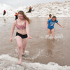 140302 Polar Swim JOED VIERA/STAFF PHOTOGRAPHER-Olcott, NY-Four year veteran Demi Eadie of Newfane exits the icy waters Polar Bear Swim in Olcott Beach on Sunday March 2nd, 2014.