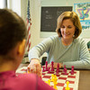 140324 CHESS JOED VIERA/STAFF PHOTOGRAPHER-Lockport, NY- Mayor Anne McCaffrey and Jordan White(9) play a game of chess at the YMCA on Mar. 24, 2014.