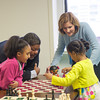 140324 CHESS JOED VIERA/STAFF PHOTOGRAPHER-Lockport, NY-Gianna Williams(8) and Jordan Bevilacqua(6) show Michael Mcduffy and Mayor Anne McCaffrey some chess moves on Mar.24, 2014.