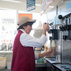 140306 Tasty Treats JOED VIERA/STAFF PHOTOGRAPHER-Lockport, NY-Nanette Frey owner of Tasty Treat makes an ice cream cone at the stand on Thursday, Mar. 6th, 2014