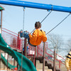 140331 3A Ent JOED VIERA/STAFF PHOTOGRAPHER-Lockport, NY-A kid plays on the swing set at Day Road Park. Mar. 31, 2014.