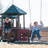 140331 3A Ent JOED VIERA/STAFF PHOTOGRAPHER-Lockport, NY-Christopher and Caitlin O'Connor play on the swing set at Day Road Park. Mar. 31, 2014.
