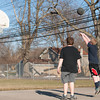 140318 Enterprise JOED VIERA/STAFF PHOTOGRAPHER-Lockport, NY- Austin Wagner watches as Dustin Whitmyer shoots a basketball at Dolan Park  on Tuesday, Mar. 18th, 2014.