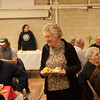 140319 St. Josephs JOED VIERA/STAFF PHOTOGRAPHER-Lockport, NY- Clara Bucolo 88 walks back to her seat desert in hand at All Saints Parish for the St Josephs feast on Wednesday, Mar. 19th, 2014.