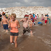 140302 Polar Swim JOED VIERA/STAFF PHOTOGRAPHER-Olcott, NY-Swimmers exit the icy waters of Lake Ontario during the  Polar Bear Swim in Olcott Beach on Sunday March 2nd, 2014.