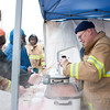 140302 Polar Swim JOED VIERA/STAFF PHOTOGRAPHER-Olcott, NY-Barker Fire Department's Ed Dysard pours chili for Karl Kones of the Pekin Fire Department before the Polar Bear Swim in Olcott Beach on Sunday March 2nd, 2014.