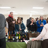 140315 Wine JOED VIERA/STAFF PHOTOGRAPHER-Lockport, NY- Attendee's try out the wine offerings at Schulze Winery during the Wine tasting event at Newfane's Community Center on Friday, Mar. 15th, 2014.