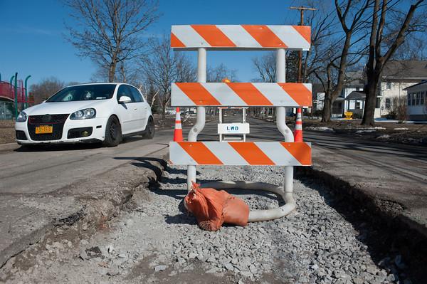 140331 Sinkhole JOED VIERA/STAFF PHOTOGRAPHER-Lockport, NY-Warnings line a dug up area of Willow St. Mar. 31, 2014.