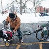 "140313 Enterprise JOED VIERA/STAFF PHOTOGRAPHER-Lockport, NY- Jerry ""The Jet"" (refused to give last name) removes his snow blower from his bike to clean a customers side walk at Harrison Ave on Thursday, Mar. 13th, 2014."