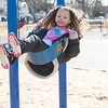 140331 3A Ent JOED VIERA/STAFF PHOTOGRAPHER-Lockport, NY-Yazmin Owens plays on the swing set in Day Road Park. Mar. 31, 2014.
