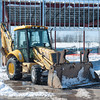 140313 Enterprise JOED VIERA/STAFF PHOTOGRAPHER-Lockport, NY- An excavator is parked at the construction site of Basil Toyota's new expansion on Thursday, Mar. 13th, 2014.