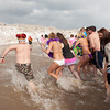140302 Polar Swim JOED VIERA/STAFF PHOTOGRAPHER-Olcott, NY-Swimmers enter the icy waters of Lake Ontario during the  Polar Bear Swim in Olcott Beach on Sunday March 2nd, 2014.
