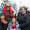 140302 Polar Swim JOED VIERA/STAFF PHOTOGRAPHER-Olcott, NY-From left: Matt, Aurora and Jill Masset chili enjoy the crowded streets before the Polar Bear Swim in Olcott Beach on Sunday March 2nd, 2014.