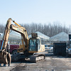 140311 Niagara Produce JOED VIERA/STAFF PHOTOGRAPHER-East Amherst, NY- Construction vehicles take a break from demolishing the old Niagara Produce building on Tuesday, Mar. 11th, 2014.