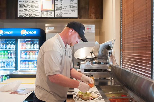 "140519 Sandwich Shop JOED VIERA/STAFF PHOTOGRAPHER-Lockport, NY- John Eagan makes a ""Big Z"" sandwich at the newly opened Canalfront Sandwich Shop. May 19, 2014"
