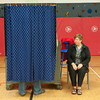 140520 Newfane School Vote JOED VIERA/STAFF PHOTOGRAPHER-Newfane, NY-Jim Scmitt makes decisions in the voting booth during the school board elections inside the Newfane Elementary School gym. May 20, 2014