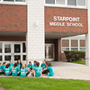 140425 Girls on a Run JOED VIERA/STAFF PHOTOGRAPHER-Pendleton, NY-Starpoint 6th graders talk before a run outside of the School. April 25, 2014.