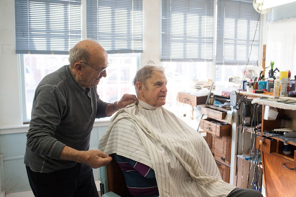 140424 Middleport Barber VIERA/STAFF PHOTOGRAPHER-Middleport, NY- Michael Reale chats with long time customer Herb Koenig in his barbershop on Main St in Middleport April 24, 2014.