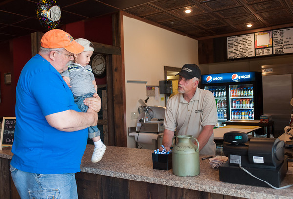 140519 Sandwich Shop JOED VIERA/STAFF PHOTOGRAPHER-Lockport, NY-Barry Griffith and his grandson Lucas Sandy order a sandwich from owner Bob Leister at the newly opened Canalfront Sandwich Shop. May 19, 2014