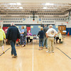 140520 Newfane School Vote JOED VIERA/STAFF PHOTOGRAPHER-Newfane, NY-newfane town residents line up to check in and vote during the school board elections inside the Newfane Elementary School gym. May 20, 2014