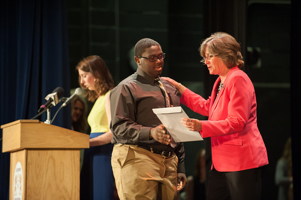 140521 LHS Awards JOED VIERA/STAFF PHOTOGRAPHER-Lockport NY-Marcelus Hinton  accepts the Eugene and Loraine Williams Leadership Award during the schools senior awards ceremony. May 21, 2014