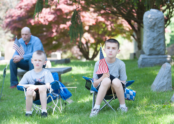 140525 Memorials JOED VIERA/STAFF PHOTOGRAPHER-Lockport, NY- Nick (5) and Anthony (8) Gagliardi observe the Memorial Day ceremony at Cold Spring cemetary. May 25, 2014.