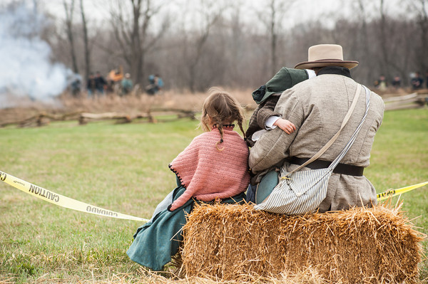 140426 MedinaReenactment VIERA/STAFF PHOTOGRAPHER-Medina, NY-Stanley Skolny holds his daughter Jessica while watching  the reenactment with his daughter Daniela . April 26, 2014.