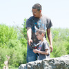 140525 Fishing Derby JOED VIERA/STAFF PHOTOGRAPHER-Lockport, NY-Norberto Negron helps his son Angel Negron (6) with his pole during thier fishing outing on the canal May 25, 2014.