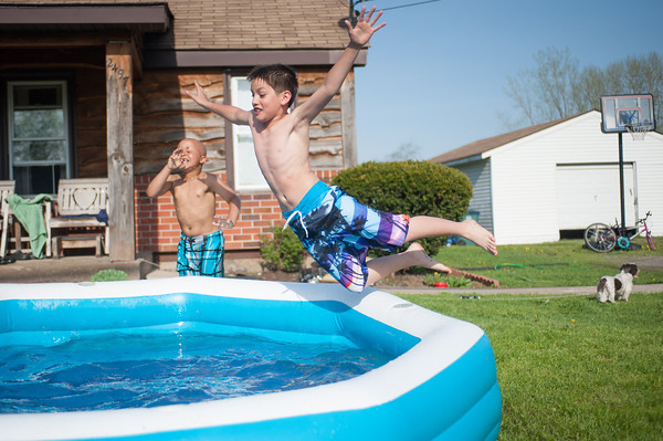 140511 Enterprise JOED VIERA/STAFF PHOTOGRAPHER-Newfane, NY-Maison Luna (11) jumps into a cool swimming pool. May 12, 2014