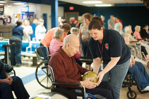 140515 Broidy Bowls JOED VIERA/STAFF PHOTOGRAPHER-Lockport, NY-Jackie Gingerich hands Harold Bergquist a Broidy Health Care Facility resident a bowling ball at Allie Brant Lanes<br /> . May 15, 2014