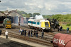 24 My 2014 :: The Paxman Valenta engine on the prototype HST power car 41001 is bough to life uner the gaze of a group of enthusiasts at the Didcot Railway Centre.  On the left is Class 14 (Teddy Bear) No D9516