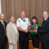 140512 Salvation Army JOED VIERA/STAFF PHOTOGRAPHER-Lockport, NY-Salvation Army Board Chairman Tim Dombrowski(left) and Major John Wheeler(right) present an award to the Ancient Order of Hibernians (from left) Matt Obyrne, Bill Costello and Anne Rotella. May 12, 2014