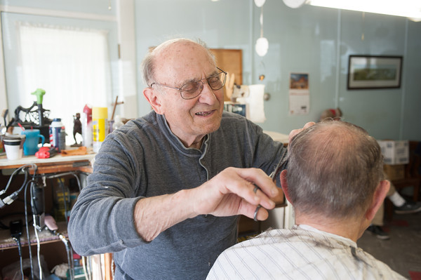 140424 Middleport Barber VIERA/STAFF PHOTOGRAPHER-Middleport, NY- Michael Reale gives long time customer Herb Koenig a haircut in his barbershop on Main St in Middleport April 24, 2014.