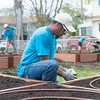 140510 Gardens JOED VIERA/STAFF PHOTOGRAPHER-Lockport, NY-Will Lewis installs an irrigation system at the new community garden on the corner of Ontario St. and Hawley St. May 10, 2014