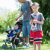 140525 Fishing Derby JOED VIERA/STAFF PHOTOGRAPHER-Lockport, NY-Norberto Negron  Angel Negron (6) looks out for fish while his father Norberto Negron plays with his baby brother Eli Negrom (1) during thier fishing outing on the canal May 25, 2014.