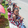 140525 Parade JOED VIERA/STAFF PHOTOGRAPHER-Lockport, NY-Christina Wiley (6), Lyric Starks (2) and Jaimee Wiley (5)watch the Memorial day parade  May 25, 2014.