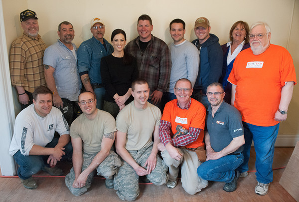 140430 Homeless vet JOED VIERA/STAFF PHOTOGRAPHER-Lockport, NY-Volunteers working on renovating a home to be used to house recovering veterans stand for a group photo. April 30, 2014