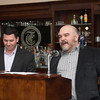 140326 LBA JOED VIERA/STAFF PHOTOGRAPHER-Lockport, NY- Erik Bernardi listens while Jason Wulf gives a speech after accepting the Lockport business of the year award at the Lockport Country Club Mar.27, 2014.