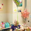 140425 Skyla JOED VIERA/STAFF PHOTOGRAPHER-Buffalo, NY-Skyla Dennis ties a get well soon balloon on to her wrist at Roswell Cancer Institute. April 23, 2014.