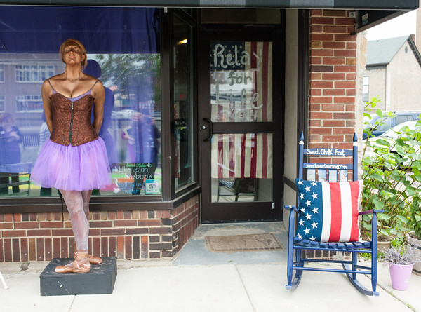 """140523 Purple JOED VIERA/STAFF PHOTOGRAPHER-Lockport NY- Rachel Winter poses as a bronzed purple baellerina outside of Sweet Rides during paint the city purple May 23, 2014. LPT Paint Lockport Purple 052414<br /> Over 30 local businesses decked out their windows and walls with purple decorations for the annual """"Paint the City Purple"""" event to promote next month's American Cancer Society Relay for Life. Many shops and businesses decorated with stars and stripes as well to coordinate with the theme of """"Star-Spangled Relay"""". Mayor Anne McCaffrey announced """"Paint the City Purple Day"""" Friday morning in front of city hall and a panel of five judges scoped out the participants to choose winners. Donna Eick's restaurant won the small business award, First Niagara bank on East Avenue. Tom's Diner won the hospitality award, and the new Canalfront Sandwich shop won the Rookie award."""