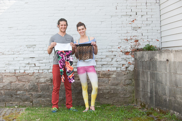 140508 LPT Clothing Business JOED VIERA/STAFF PHOTOGRAPHER-Lockport, NY-Justin Hosey and Hannah Sharp hold up handmade workout clothes from their business High Spirits outside of Ultimate Physique. May 7, 2014