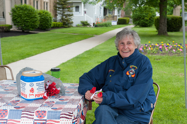 140523 PoppiesJOED VIERA/STAFF PHOTOGRAPHER-Middleport, NY- American Legion Axuiliary Volunteer Ann Rook gives away poppies for donations outside of Keybank. May 23, 2014.