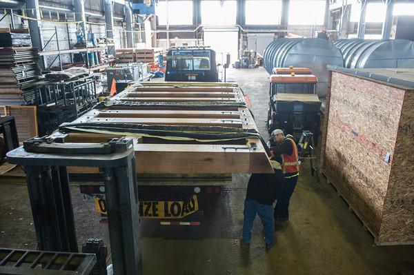 140505 Wood Door JOED VIERA/STAFF PHOTOGRAPHER-Tonwanda, NY- A crew secures one of the Locks' doors. May 5, 2014