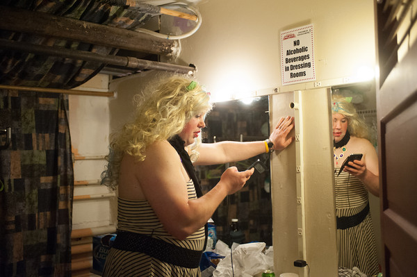 140510 Peaches JOED VIERA/STAFF PHOTOGRAPHER-Lockport, NY-Miss Amanda Huggenkiss aka James Pettapiece checks her/his phone while backstage at the Palace Theater during the Peaches & Creme Fashion show. May 10, 2014