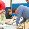 140520 Newfane School Vote JOED VIERA/STAFF PHOTOGRAPHER-Newfane, NY-Jim Scmitt checks in before voting during the school board elections inside the Newfane Elementary School gym. May 20, 2014